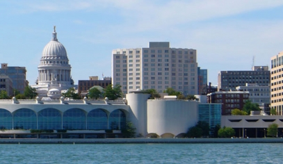 Part of the Madison skyline as seen from Lake Monona, with Monona Terrace in the middle and the capitol directly behind it.