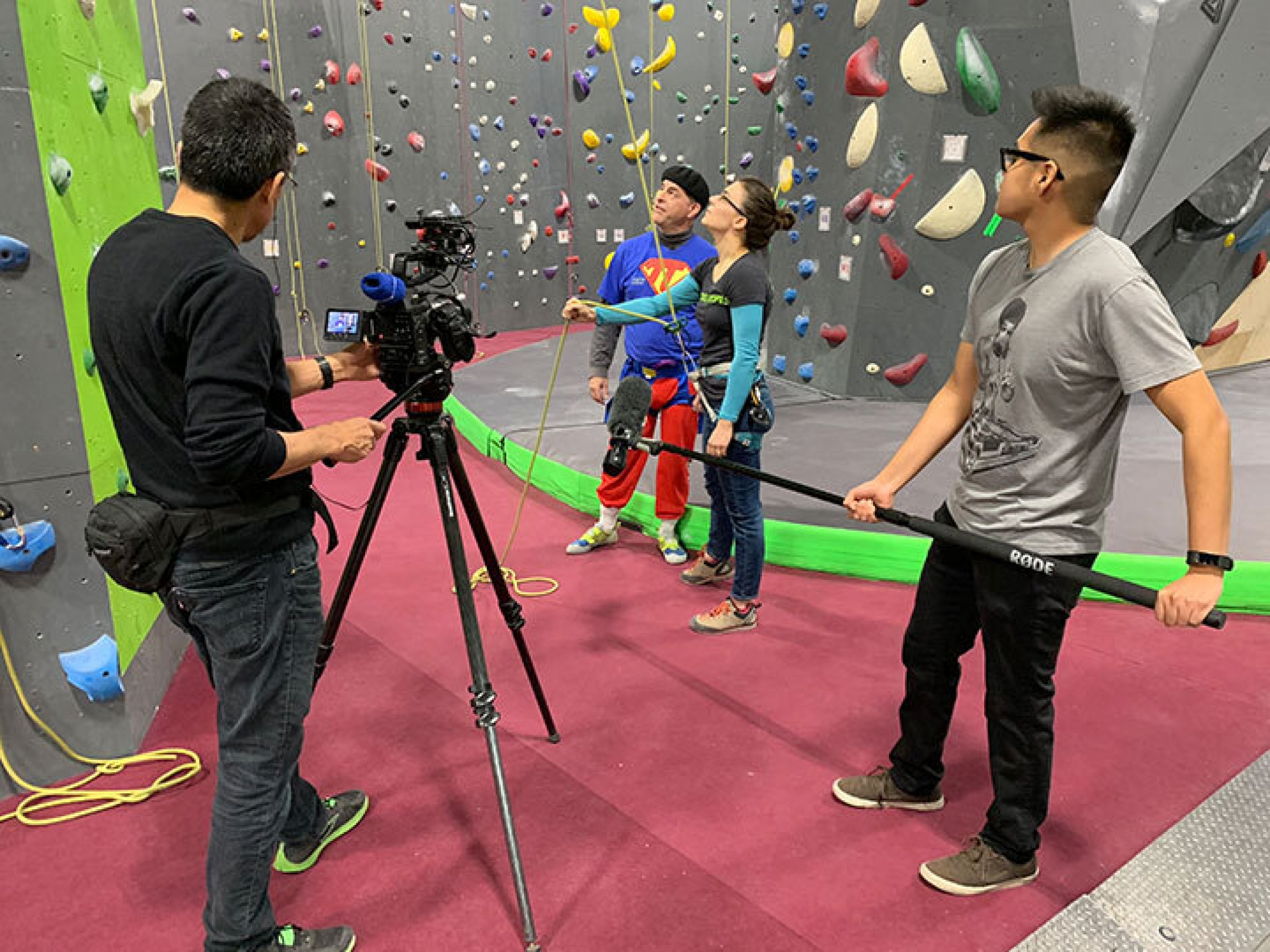 Filming a physics demonstration at a rock climbing gym