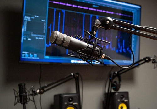 Digital Learning Studios' new podcast room microphones and screen